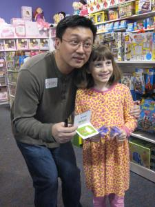 Choon presenting Katy with her gift card.