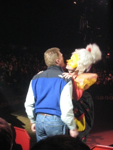 Audience member gets a kiss from the clown