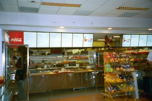 The high school cafeteria at the new campus. When we were in school everything was cooked to order but on the new campus it is so big and everyone eats at once so now everything is under heat lamps.