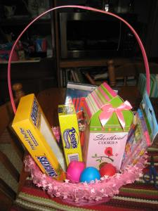 Easter Bunny loot. She got a Wreck-It Ralph DVD, pencils, shortbread cookies in a box that looks like a birdhouse, Peeps and a peanut butter Snickers bunny. The cascarones (confetti) eggs were in the basket instead of hidden in the yard since they won't do well in the rain.