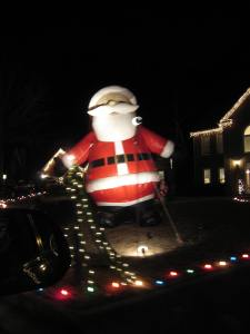 Gigantic Santa. If that thing fell forward it would block the road
