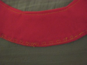 Collar with fancy heart stitching.