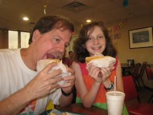 Heath and Katy enjoying their hamburger and hotdog.
