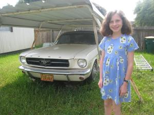 Katy and her car. Daddy wants to give it to her when she turns 18, I told her she'd be lucky to see it by the time she finishes college.