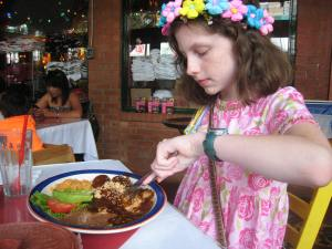 Katy had chicken enchiladas with mole and loved i.