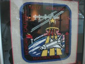 Hand-sewn team patch. The glare off the glass is bad.
