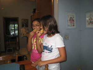 Catherine and Elizabeth sampling curry puffs