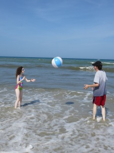 Heath and Katy playing with the beach ball