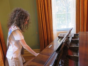 Katy playing the piano in the parlor (the docent asked if anyone could play).