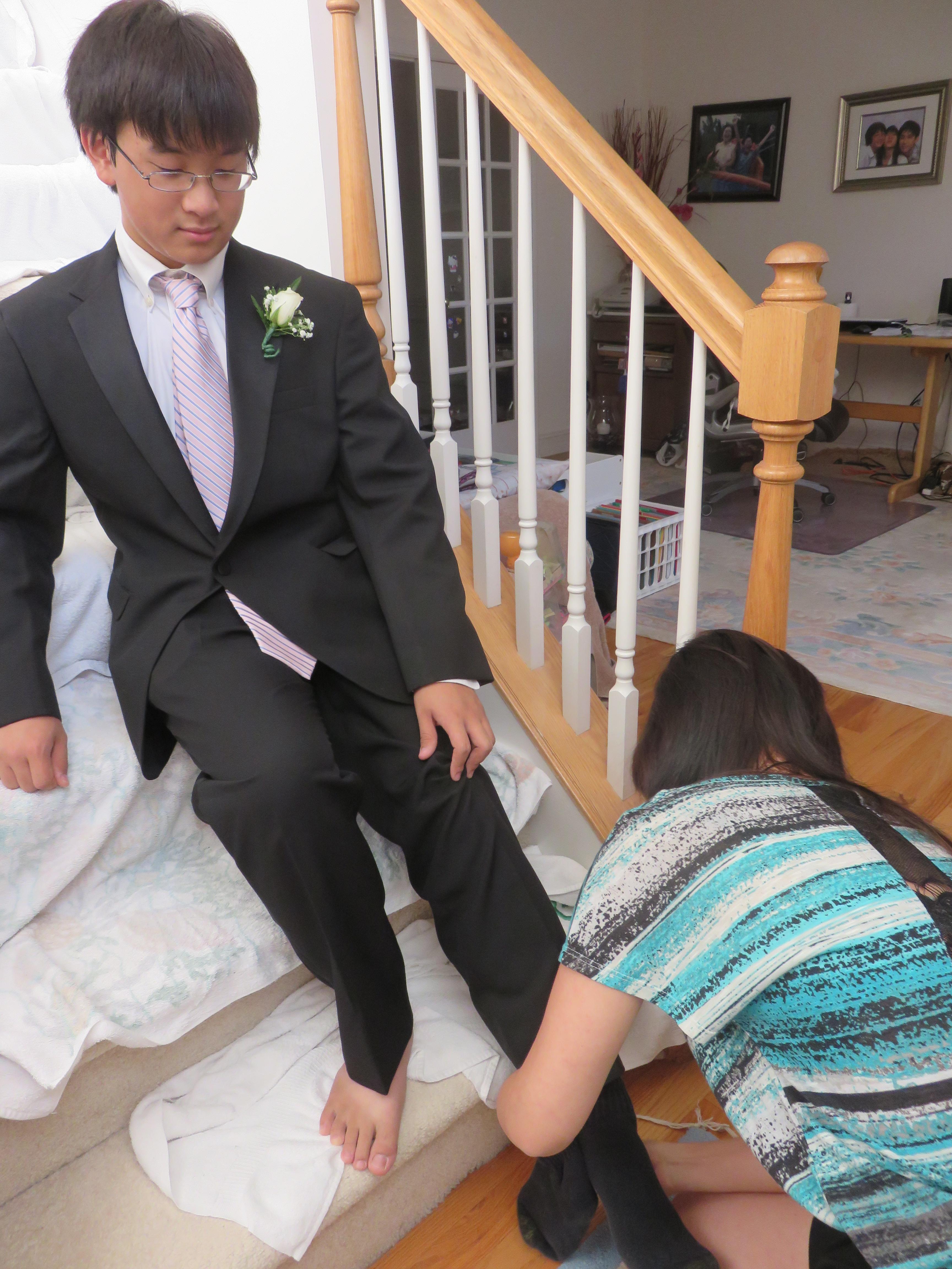 Emily putting Steven's socks on him!