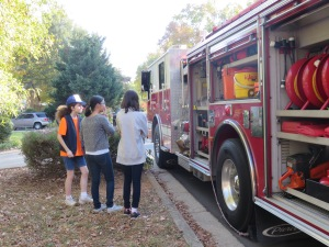 Katy, Catherine and Elizabeth checking out the fire truck.