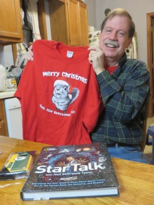 We gave him a sweatshirt, Neil deGrasse Tyson book and a Packer cellphone case.