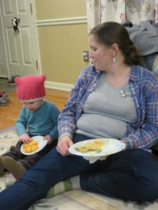Wyatt got his plate of cantaloupe and waddled over to sit by his mom.